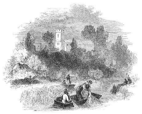 People Fishing on the Avon River at Bidford-on-Avon in Warwickshire, England