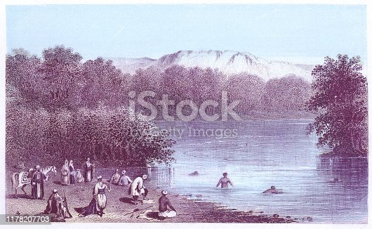 People swimming in the River Jordan in the West Bank, Palestine. Vintage colour etching circa mid 19th century.