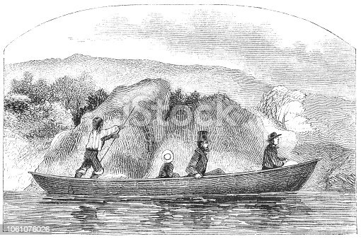 Small group of people traveling by boat down the Penobscot River in Maine, United States of America (circa mid 19th century). Vintage etching circa mid 19th century.