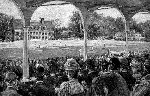 Crowd of people watching a cricket match at Germantown Cricket Club in Philadelphia, Pennsylvania, USA. Vintage etching circa late 19th century.