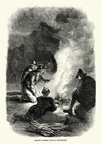 Vintage engraving of Pilgrim Fathers round a watch fire. The Pilgrims or Pilgrim Fathers were the first English settlers of the Plymouth Colony in Plymouth, Massachusetts.