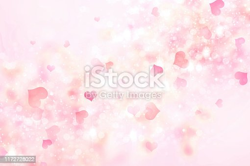 Pink abstract blurred hearts background.Valentine's day backdrop.