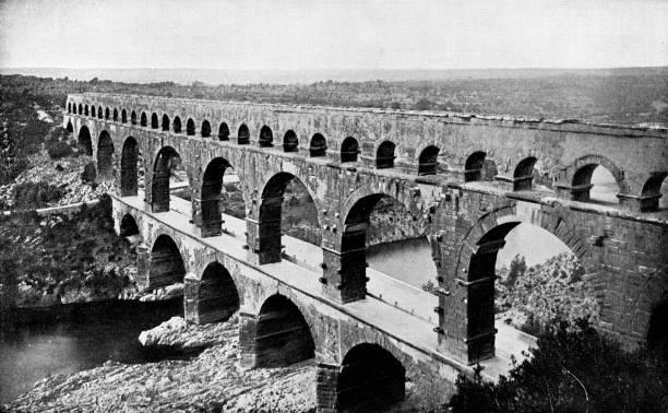 stockillustraties, clipart, cartoons en iconen met pont du gard romeins aquaduct in nîmes, frankrijk - 19e eeuw - pont du gard
