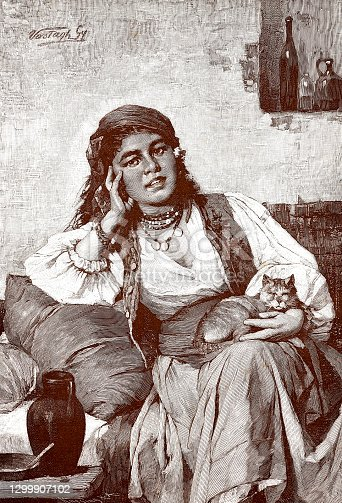 istock Portrait of a gypsy woman with a cat 1299907102