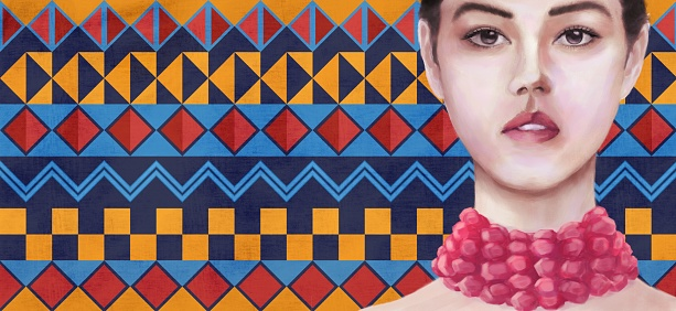 Portrait of a young woman of mixed Asian and European ethnicity against a traditional African pattern