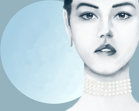 Portrait of a young woman with Asian and European roots with jewelry against the background of an open dawn sky