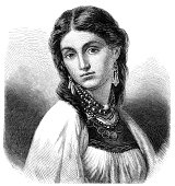 istock Portrait of beautiful gypsy woman in traditional clothing 1872 1295287614