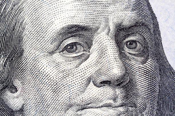 Portrait of Benjamin Franklin close-up Portrait of Benjamin Franklin in front of the one new hundred dollar bill benjamin franklin stock illustrations