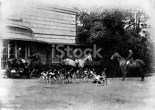 Quorn Hunt dog pack at Quorn Hall in Quorn, Leicestershire, England. Vintage etching circa late 19th century.