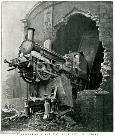 Vintage engraving from 1900 of a Railway Accident, Dublin, Ireland.  A cattle train, consisting of an engine and 26 waggons, rushed through the station at great speed, the engine striking the displacing the buffers and stop bank, and breaking through the end wall into Hatch Street.