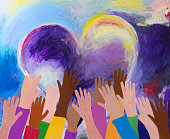 istock Raised hands and heart shape acrylic painting 1254500158