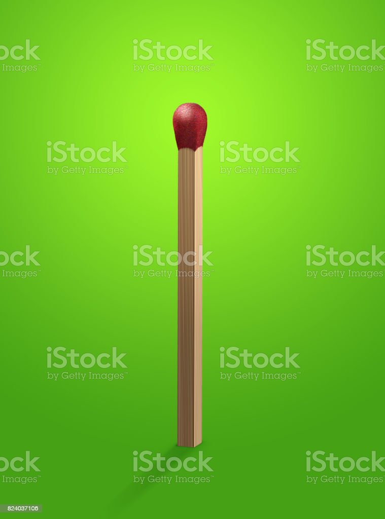 Red head match stick standing upright on green background vector art illustration