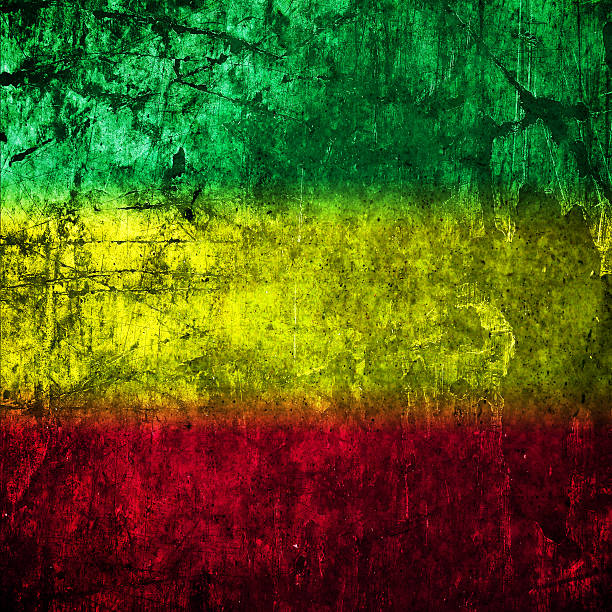 Red, yellow, green rasta flag on Concrete wall Red, yellow, green rasta flag on Concrete wall rastafarian stock illustrations
