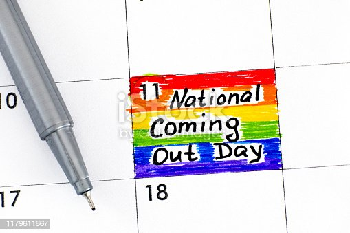 Reminder National Coming Out Day in calendar with pen. October 11. Close-up.