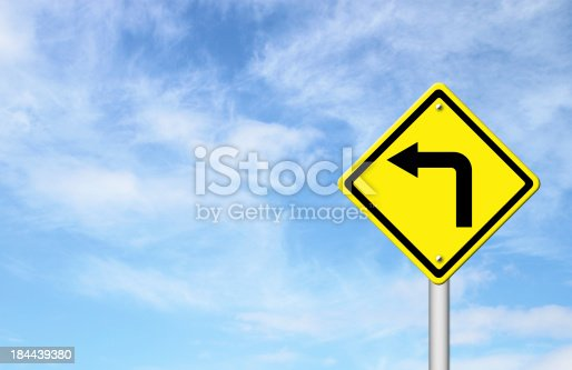 Road Sign - Left Turn Warning with blue sky blank for text