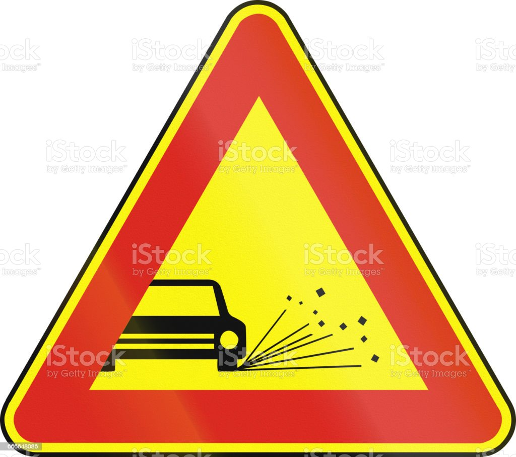 Road sign used in Slovakia - Loose chippings (as a temporary sign) vector art illustration