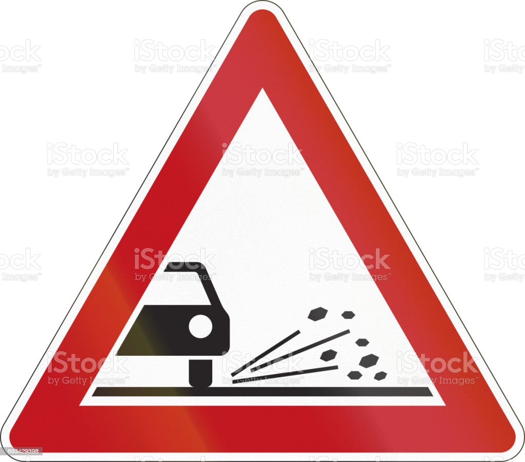 A road warning sign in Germany: Loose chippings vector art illustration