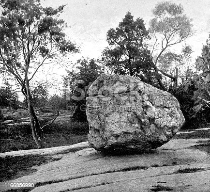 Rocking Stone in Bronx Park (Year later becoming Bronx Zoo) in The Bronx, New York City, New York, USA. Vintage etching circa late 19th century.