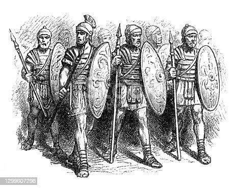 istock Roman soldiers in military uniform 4th century 1299607298