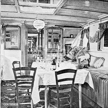 Room aboard a houseboat in Egypt. Vintage halftone etching circa late 19th century.