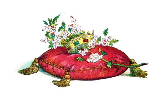 royal crown on cushion with flower blossom branch