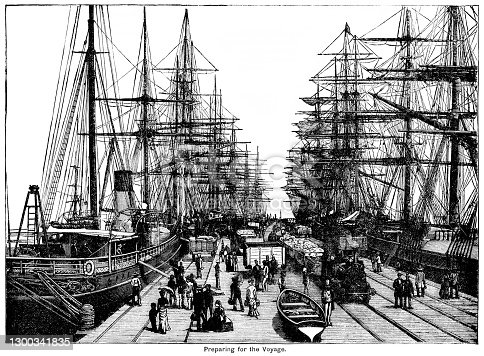 "Rows of sailing ships and steamers moored each side of a pier with passengers boarding and cargo being moved around with the help of a steam engine. From ""The Cottager and Artisan, 1889"" published by The Religious Tract Society, London."