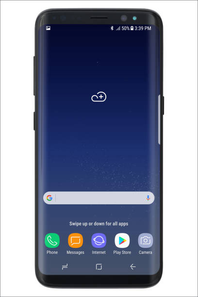 Samsung Galaxy S8 Koszalin, Poland – 25 April, 2017: Black Samsung Galaxy S8 on wooden table. Samsung S8 are new generation smartphone from Samsung. The Samsung S8 is smart phone with multi touch screen brand name stock illustrations