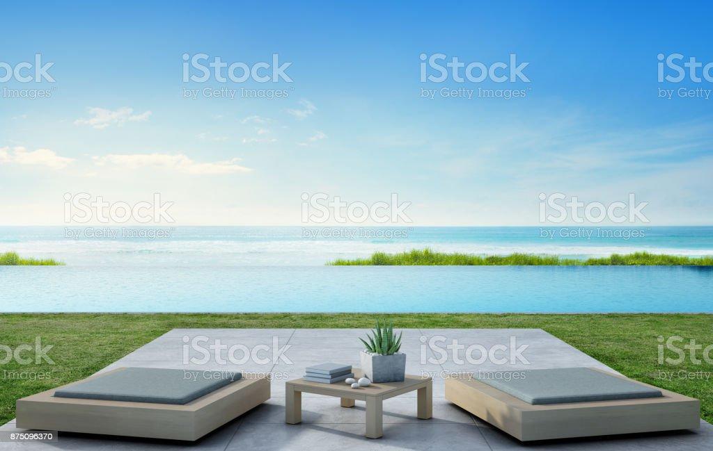 Meer Blick Swimmingpool Neben Terrasse Und Moderne Möbel In Luxus Strandhaus  Mit Blauen Himmelshintergrund,