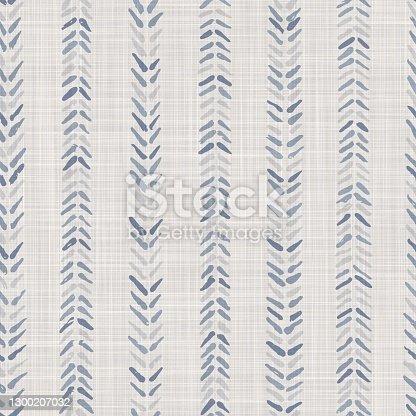 istock Seamless french farmhouse woven linen chevron texture. Ecru flax blue hemp fiber. Natural pattern background. Organic ticking fabric for kitchen towel material. Zig Zag stride material allover print 1300207032