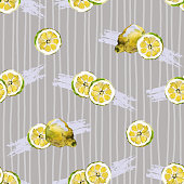 Seamless pattern of bright yellow watercolour painted lemon slices and halves on a gray vertically striped background.