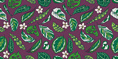Seamless pattern with exotic Calathea, Pothos and Monstera plant leaves and flowers on dark purple background