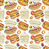 istock Seamless pattern with hamburgers, cola and hot dogs on a white background. 1286322255