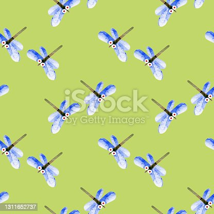 istock Seamless spring pattern with dragonflies. Cute, funny, cartoon flying damselfly, insects with light blue wings. Watercolor color illustrations on a green background. For fabric, children's design. 1311652737