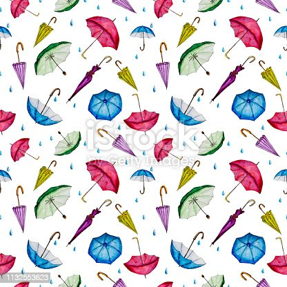 Hand drawn watercolor multicolored umbrellas and raindrops isolated on white background.