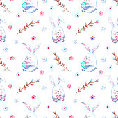 Seamless watercolor pattern with Easter bunnies, willow twigs, flowers on a white background. Illustration for holidays, fabrics, postcards, packaging.
