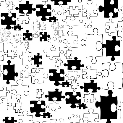 set of black and white puzzle pieces.