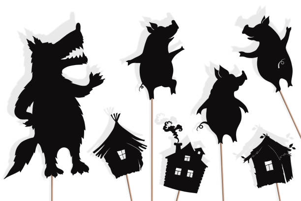 shadow puppets of three little pigs and wolf - kukiełka stock illustrations