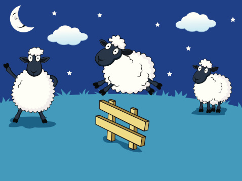 Sheep leaping over the fence