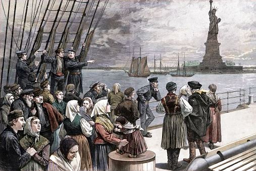Vintage engraving features a late nineteenth century depiction of an ocean steamer of European immigrants passing the Statue of Liberty in New York harbor after crossing the Atlantic.