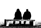 Silhouette of a couple on a modern bench