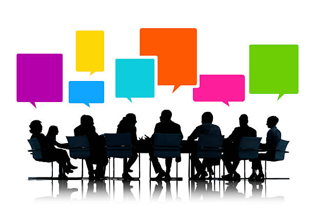 Silhouettes of Business People in a Meeting with Speech Bubbles vector art illustration