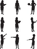 Silhouettes of women reading