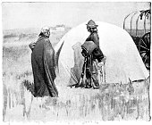 Sioux First Nations people and wigwam in North Dakota, USA. Vintage etching circa late 19th century.