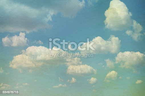 Sky with clouds in grunge textured style. Watercolor paper overlay background.