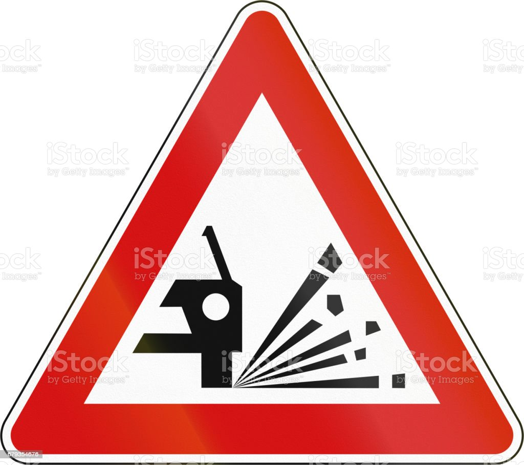 Slovenian road warning sign - Loose chippings vector art illustration