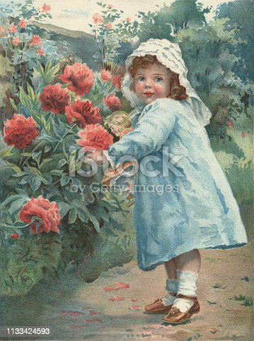 "A sweet little Victorian girl wearing a blue dress and lace bonnet and carrying her doll is picking flowers - probably peonies - in a garden. From ""Little Folks - A Magazine for the Young"" published in 1894 by Cassell & Company Ltd., London, Paris and Melbourne."