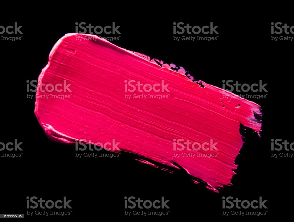 Smudged lipstick pink on a black isolated background vector art illustration