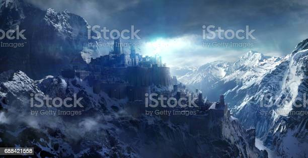 Snow-capped mountains between the castle.