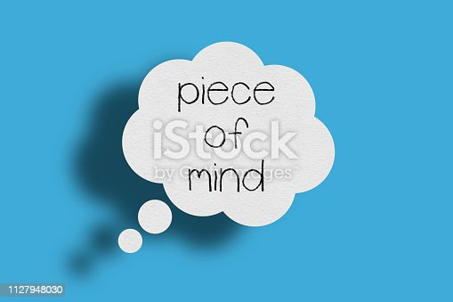 Speech bubble on blue background, Piece of mind