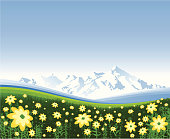 Fresh spring mountain landscape background with yellow flowers. Space for copy.